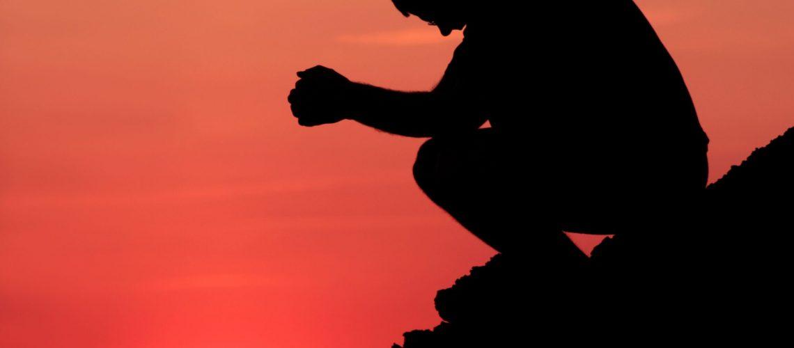 mountain-prayer-silhouette-172276604-5873fa885f9b584db36a28d2